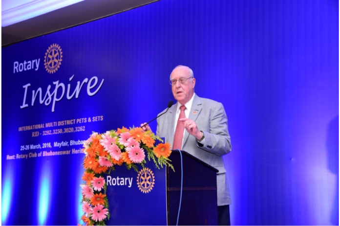 Rotary International President Elect John Germ addressing Rotarians at Mayfair Convention.