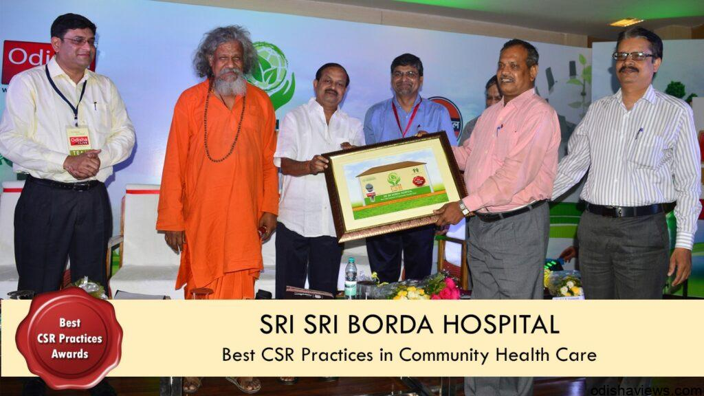 Photo receiving CSR Award by Rtn Bk Sahoo Director of SSBH from Hon'ble Minister
